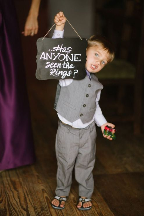 adorable-ring-bearer-with-chalkboard-wedding-signs