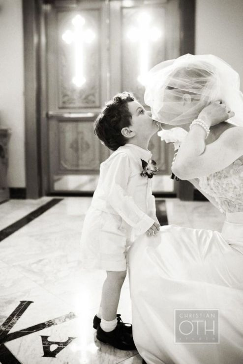 bride-and-ring-bearer-kiss-wedding-photo-ideas