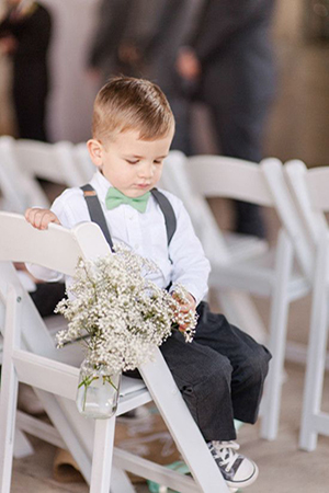 ring-bearer-in-mint-bow-tie-and-suspenders-for-rustic-wedding-ideas