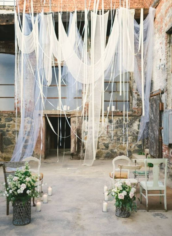 Romantic-Industrial-Loft-Wedding-Ceremony-with-Hanging-Drapery